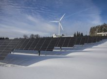 Commercial solar panels at windfarm